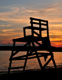 Sunset Over Niles Beach. Brilliant sunset shot from Niles Beach in Gloucester, MA with lifeguard stand in the foreground royalty free stock photography