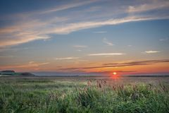 Sunset over a Norfolk Marsh royalty free stock photo