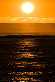 Sunset over the ocean. The sun setting over the Indian Ocean Royalty Free Stock Images