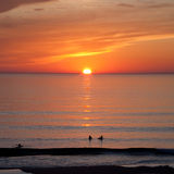 Sunset over the ocean. Kayaks on the Atlantic ocean during sunset Stock Photos