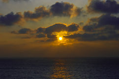 Sunset over the ocean. A bright sunset in the clouds over the ocean Royalty Free Stock Photos