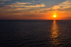 Sunset over ocean Royalty Free Stock Photos