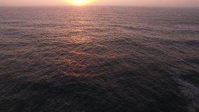 Sunset over the ocean aerial view. Sunset over the ocean aerial stock video footage