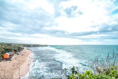 Sunset over ocean from the cliff. Tropical island Bali, Indonesia. Stock Photography