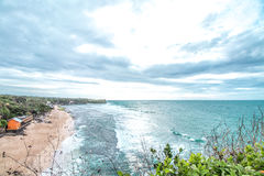 Sunset over ocean from the cliff. Tropical island Bali, Indonesia. Stock Image