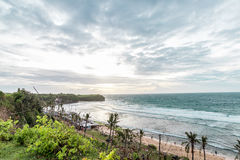 Sunset over ocean from the cliff. Tropical island Bali, Indonesia. Royalty Free Stock Photo