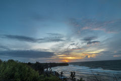 Sunset over ocean from the cliff. Tropical island Bali, Indonesia. Royalty Free Stock Images