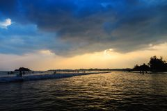 Sunset over the ocean on a cloudy day royalty free stock photo