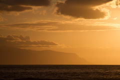 Sunset over the ocean colored sky in sepia. Stock Photos