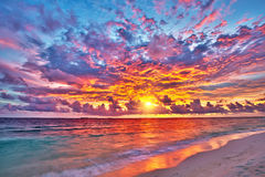 Sunset over ocean. Colorful sunset over ocean on Maldives Stock Photo