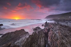 Sunset over the ocean in Garden Route NP, South Africa stock photography