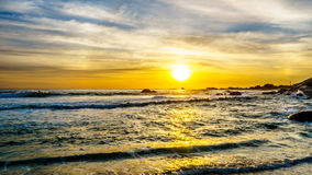 Sunset over the ocean horizon and beach on a nice winter day viewed from Camps Bay. Near Cape Town South Africa Royalty Free Stock Images