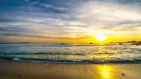 Sunset over the ocean horizon and beach on a nice winter day viewed from Camps Bay. Near Cape Town South Africa Royalty Free Stock Image