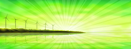 Sunset over an ocean island with wind turbines Royalty Free Stock Photos