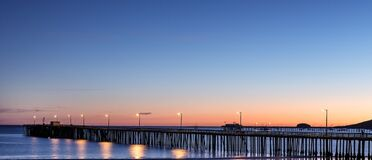 Sunset over ocean pier Royalty Free Stock Photo