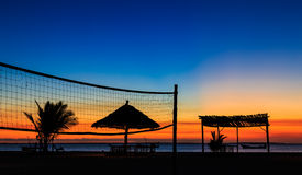 Sunset over the ocean at a resort Royalty Free Stock Image