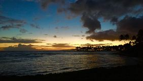 Sunset over the ocean. With shoreline on the right. Mobile upload taken in Kauai, Hawaii Royalty Free Stock Photos