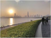 Shenzhen city and sunset. Sunset over the ocean with silhouette of Shenzhen city, China Royalty Free Stock Photo