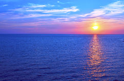 Sunset over ocean in summer Royalty Free Stock Images