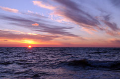 Sunset over ocean in summer Royalty Free Stock Image