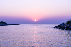 Sunset over the ocean in the violet color Royalty Free Stock Images