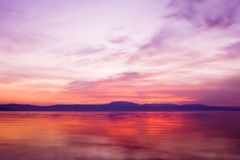 Sunset over ocean water stock images