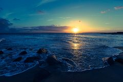 Sunset over ocean waves Royalty Free Stock Photography