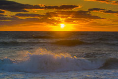 Sunset over the ocean with waves Royalty Free Stock Photography