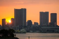 Sunset over office buildings in Tokyo Stock Photos