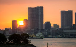 Sunset over office buildings in Tokyo Royalty Free Stock Photos