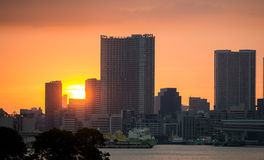 Sunset over office buildings in Tokyo Royalty Free Stock Images