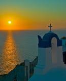 Sunset over Oia Santorini. A Sunset in Santorini over the town of Oia Stock Photos