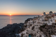 Sunset over Oia village in Santorini Royalty Free Stock Images