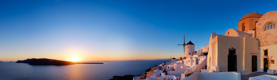 Sunset over Oia village on Santorini island in Greece Stock Photo