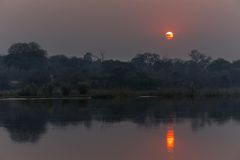 Sunset over the Okavango River Stock Image