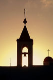 Sunset over the old Akko church. Silhouette of a belfry on sunset royalty free stock photo