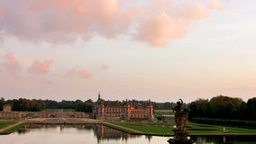 Sunset over old castle Chantilly stock video footage
