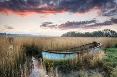Sunset over an old fishing Boat Stock Photography