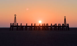 Sunset over old pier Royalty Free Stock Photography