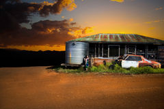 Sunset over old shack Stock Images