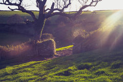 Sunset over an old stone gate in rural landscape Royalty Free Stock Images