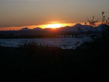 Sunset over Olympic Mountains and Puget Sound. A sunset near Edmonds, WA over the Olympic Mountains and Puget Sound Stock Images
