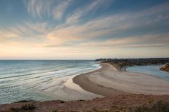 Sunset over the Onkaparinga River mouth looking north towards th. E Port Noarlunga Jetty in South Australia on 23rd September 2018 royalty free stock photo