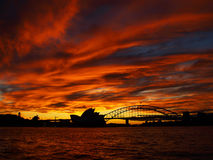 Sunset over the Opera House and the Harbour Bridge Royalty Free Stock Images
