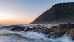 Sunset over Oregon beach stock photo