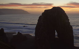 Sunset Over the Pacific. Colourful sunset over the pacific ocean at the coastal town of Constitucion in Maule, Chile. In the foreground are the Rocas de los Royalty Free Stock Photo