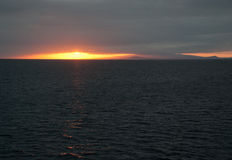 Sunset off Galapagos Island Stock Photos