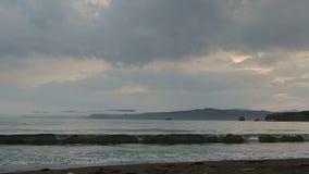 Sunset over Pacific Ocean in the Bay Zavoiko. stock video