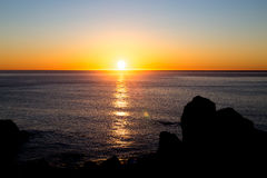 Sunset Over Pacific Ocean Stock Photo