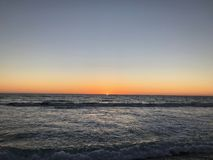 Sunset over Pacific Ocean - California Dream. Orange glow on the horizon as sun sets over the Pacific Ocean from a California Beach in Oceanside royalty free stock photo